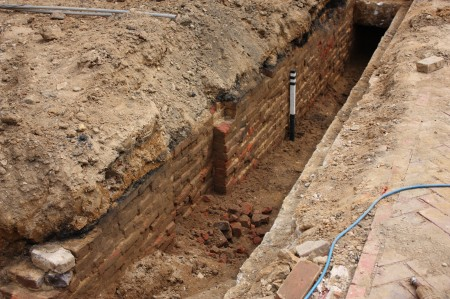 Looking along the 18th c. brick foundation of the front (west) wall of the Chew House (looking south)