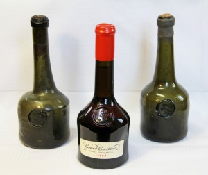A bottle of 2008 Grand Constance flanked by intact 18th-century bottles from Sweden and Belgium that once contained Constantia Wyn.
