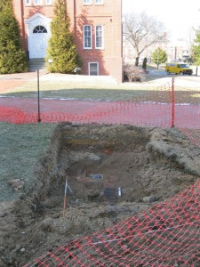Test hole outside The Old State House where a previously undocumented brick foundation was uncovered.