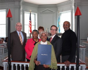 Harriet Tubman (as portrayed by Delores Blakey) holding a copy of the Harriet Tubman Day proclamation. Behind her are (from left) Delaware Division of Historical and Cultural Affairs Director Tim Slavin; the Rev. Rita Mishoe Paige, pastor of Star Hill African Methodist Episcopal Church in Dover; Ann Gravatt from the Delaware Department of Transportation; Chief Deputy Secretary of State Rick Geisenberger; and state Rep. Donald Blakey.