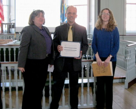 DelawareDivision of Historical and Cultural Affairs Deputy Director Suzanne Savery (left) and Deputy State Historic Preservation Officer Gwen Davis present a certificate of appreciation to retiring State Review Board for Historic Preservation board chair Kevin Rychlicki.