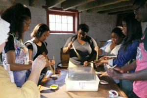 Delaware State University freshmen participating in a paper-marbling training session at the John Dickinson Plantation.