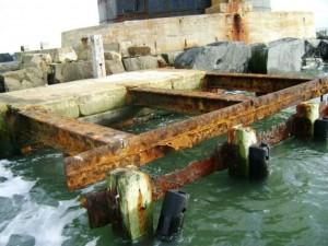 Storm-damaged dock at the Harbor of Refuge Lighthouse.