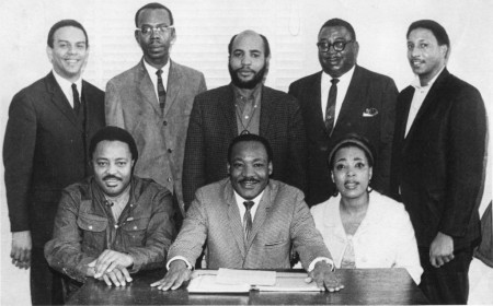 "Dr. Martin Luther King, Jr. (seated, center) with staff members of the Southern Christian Leadership Conference. Dr. Dorothy Cotton is seated on the right. Cotton will be the keynote speaker at the symposium, ""The Civil Rights Movement in Delaware: Its History—Its Legacy,"" on Oct. 2, 2014."