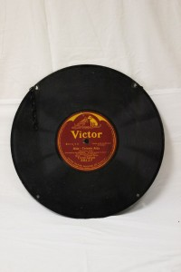Metal  advertising-sign made in the shape of a record. From the collections of the state of Delaware.