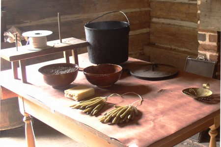 Hand-dipped candles (bottom center) and the materials needed to produce them at the John Dickinson Plantation. Candle-dipping workshops will be held at the plantation on Nov. 19, 2016.