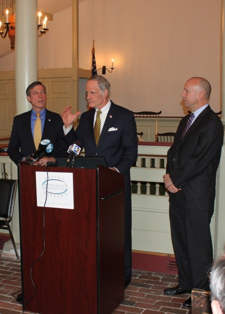 U.S. Sen. Tom Carper speaking at the celebration marking the creation of the First State National Historical Park. Flanking Carper are (left) U.S. Rep. John Carney and Delaware Gov. Jack Markell.