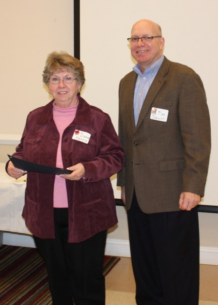 Division accountant Dianna Harris honored for 30+ years of service to the state of Delaware. At right is division director Tim Slavin.