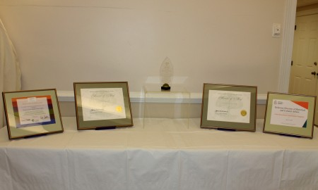 Division awards on display at the end-of-the-year success event.