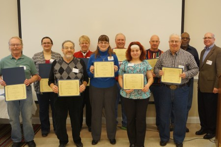 Division volunteers honored at the end-of-the-year success event. (From left) Larry Watkins, Valarie Shorter, David Perlmutter, Carolyn Apple, Laura Herbin, Jim Schilling, Caroline Dworkin, Gene Modzelewski, Arnold Leftwich and Howard Fulcher. Division director Tim Slavin is at the far right.