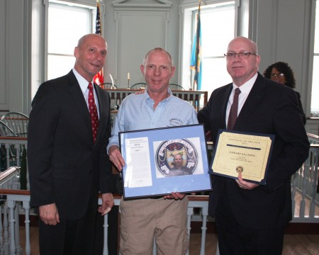 Ed Gillespie (center) holding his Delaware Department of State Employee of the Year award. Flanking Gillespie are (left) Delaware Secretary of State Jeffrey W. Bullock and Division of Historical and Cultural Affairs Director Tim Slavin.