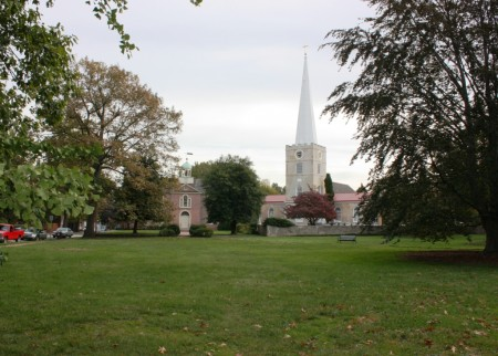 New Castle Green with the Academy building at left and Immanuel Episcopal Church at right.