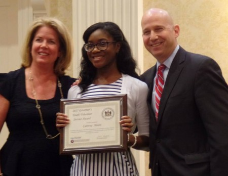 Catrena Moore (center) with Delaware first lady Carla Markell and Gov. Jack Markell at the 2015 Governor's Youth Volunteer Service Awards ceremony on April 21, 2015.