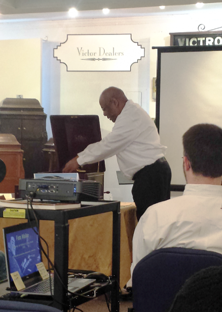 """Long-time volunteer Howard Fulcher conducting a public program on """"Fats"""" Waller at the Johnson Victrola Museum on Feb. 21, 2015. Fulcher also serves on the division's Community Engagement Committee that is developing a marketing plan for the agency."""