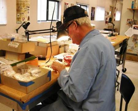 Delaware Division of Historical and Cultural Affairs volunteer Kent Slavin assisting with the analysis of artifacts from the Roosevelt Inlet Shipwreck.