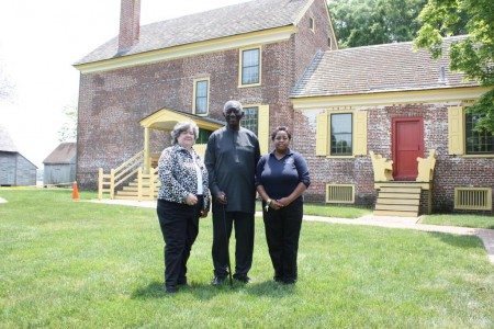 (From left) Division of Historical and Cultural Affairs Deputy Director Suzanne Savery, President John Kufuor and site supervisor Gloria Henry behind the John Dickinson Plantation's mansion house.