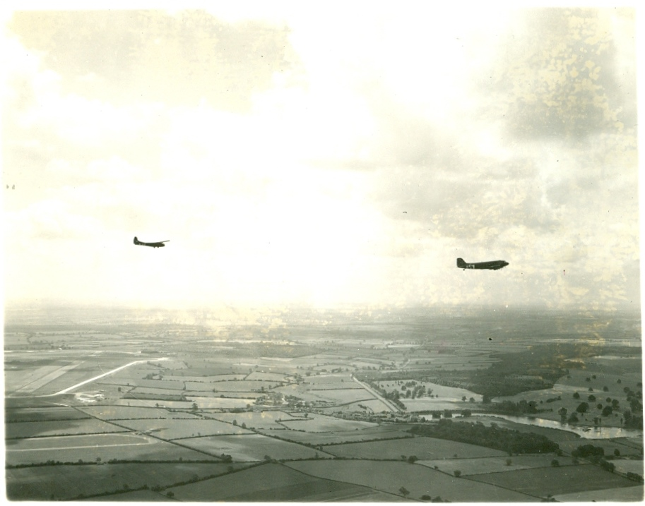 Photograph of a C-47 Skytrain towing a Waco CG-4A glider.