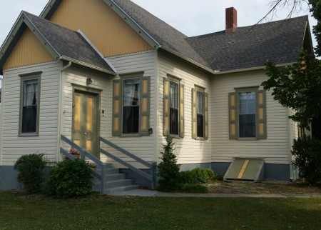 Exterior of the Milford Century Club after repairs and repainting.