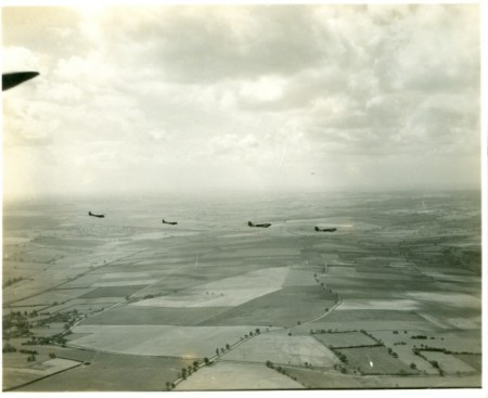 Photograph of two C-47 Skytrains each towing a Waco CG-4A glider.