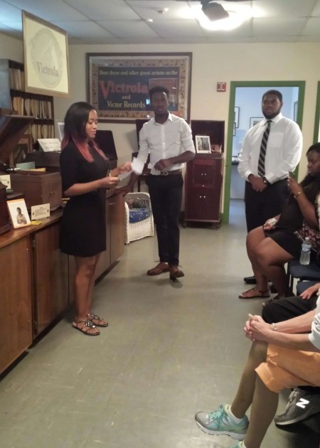 (Standing, from left) Delaware State University students Arielle Wade, Kobe Washington and Brandon Pretlow conducting a program at the Johnson Victrola Museum.