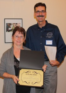 Jan Rettig, holding her Extra Mile Award, and Edward McWilliams, manager of the CARE Team which nominated Rettig.
