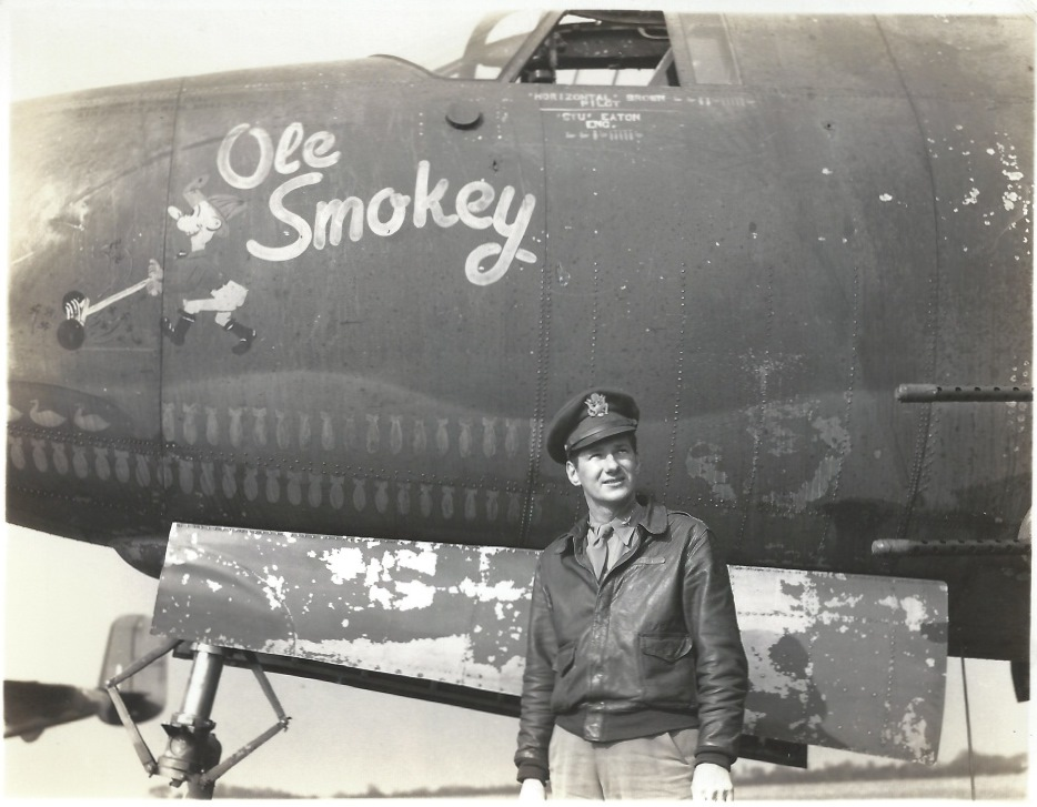 "Mission symbols on a B-26 bomber. Capt. James ""Jim"" C. Brown, pilot from the 557th Bomb Squadron of the 387th Bomb Group standing in front of ""Ole Smokey."""