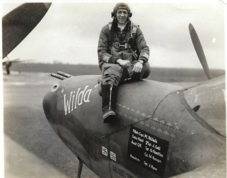 "Mission symbols on a P-38 Lightning fighter aircraft. Capt. Merle B. Nichols of the 79th Fighter Squadron, 20th Fighter Group, 8th Air Force, sitting atop ""Wilda."""