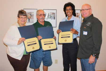 Division employees honored for their years of service. (From left) Madeline Dunn, Dan Davis and Nena Todd. Division director Tim Slavin is at the far right. Davis was also honored with an Extra Mile Award.