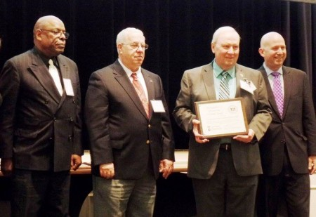Volunteer staff of the Johnson Victrola Museum honored at the 2015 Governor's Outstanding Volunteer Awards ceremony. From left: volunteers Howard Fulcher, Arnold Leftwich and Jim Schilling, and Gov. Jack Markell.