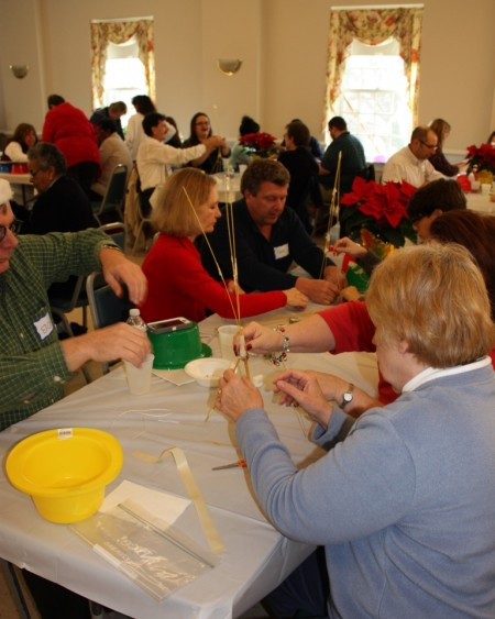 Division staff, volunteers, partners and friends participating in the Marshmallow Challenge.