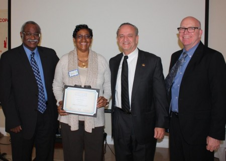 Josie Roy holding her Certificate of Appreciation in Preservation. From left are New Castle County Deputy Chief Administrative Officer Sam Guy, Roy, New Castle County Executive Tom Gordon and division director Tim Slavin.