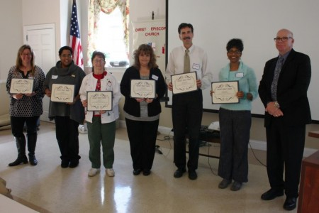 Members of the division's American Association of Museums accreditation team holding their Biggest Impact awards. From left are Vertie Lee, Gloria Henry, Jan Rettig, Cherie Dodge-Biron, Edward McWilliams, Marian Carpenter and division director Tim Slavin.