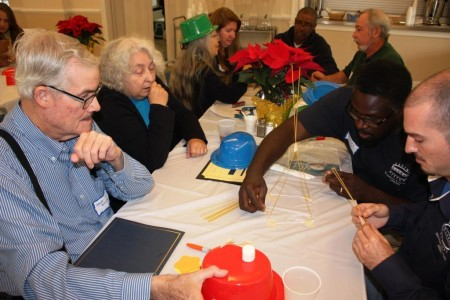 Taking the Marshmallow Challenge: (Clockwise from lower left) Kent Slavin, Alice Guerrant, Jennifer Dunham, Charity Luksha, Melvin Mitchell, Dan Davis, James Scott and Scott Hayes.