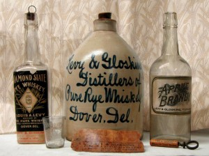 """Containers and accessories from Levy & Glosking distillers of Dover, Del. Part of the exhibit, """"Wine and Spirits in Delaware: Producing, Preserving, and Presenting."""""""