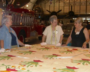 Volunteers cataloging a quilt at an earlier Quilt Harvest Day.