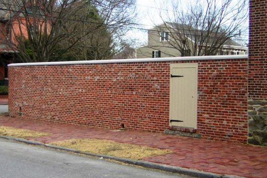 Photo of the completed section of the New Castle Academy garden wall