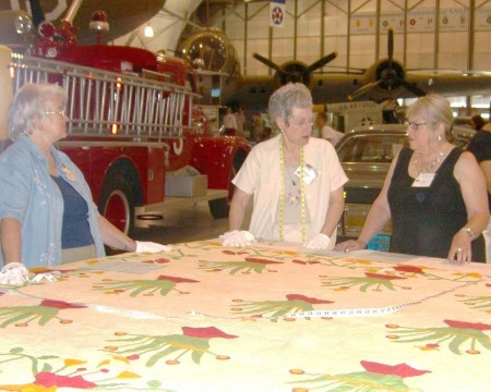 Volunteers cataloging a quilt at an earlier Quilt Documentation Day.