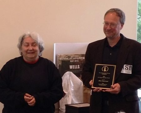Alice Guerrant prepares to receive her H. Geiger Omwake Award from Archaeological Society of Delaware President Craig Lukezic.