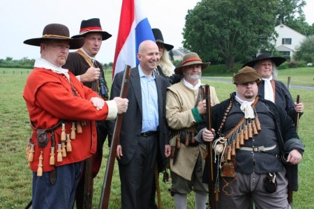 Gov. Jack Markell with historical reenactors from the Garrison of New Amstel.