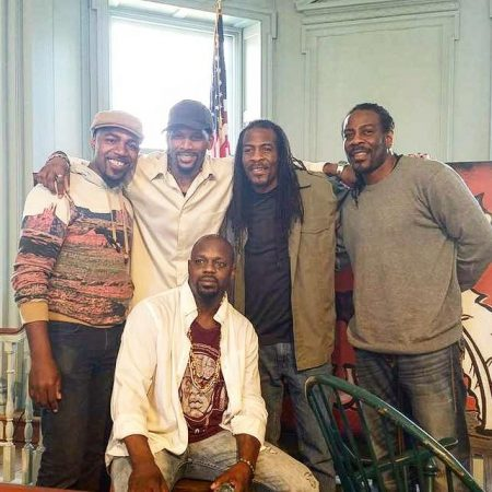 """Listen Up! instructors. (From left, standing) Marquette Shaw; James Alexander; the Twin Poets--Nnamdi Chukwuocha and Albert Mills; and (seated) Brock Kalim."
