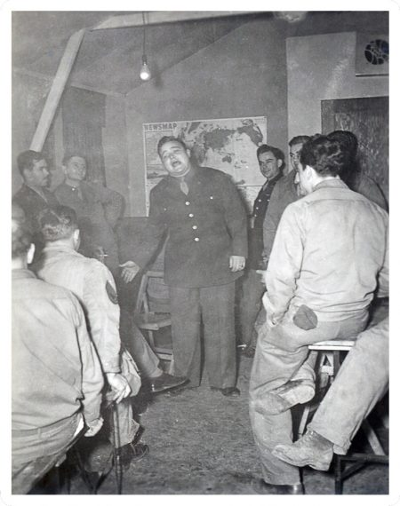 "Photograph of ""chow"" entertainment from ""World War II Through the Lens of William D. Willis: a photographic exhibit."""