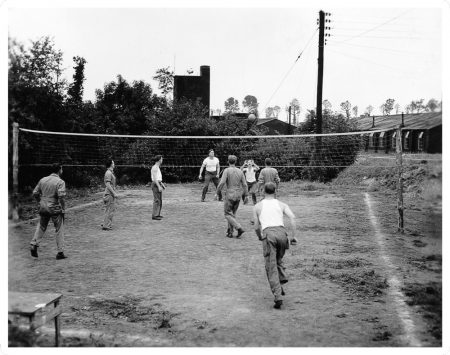 "Photograph of servicemen playing volleyball from ""World War II Through the Lens of William D. Willis: a photographic exhibit."""
