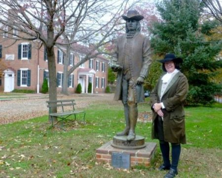 New Castle resident Jim Whisman as William Penn in front of the Penn statue. The Arsenal building is in the background.