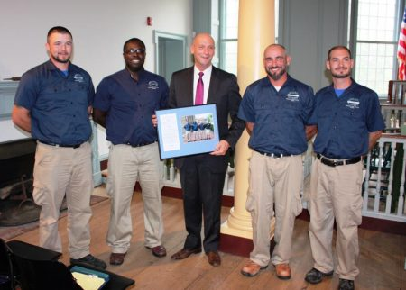 Delaware Secretary of State Jeffrey W. Bullock with the winners of the Department of State's 2016 Employee of the Second Quarter award. (From left) Chris Conley, James Scott, Bullock, Greg Buchman and Scott Hayes.
