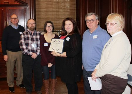 Cindy Snyder (holding her Biggest Impact Award) with staff from the New Castle Court House Museum. (From left) Division Director Tim Slavin, David Price, Nicole Worthley, Snyder, Bob Vander Decker and Joan Foster.