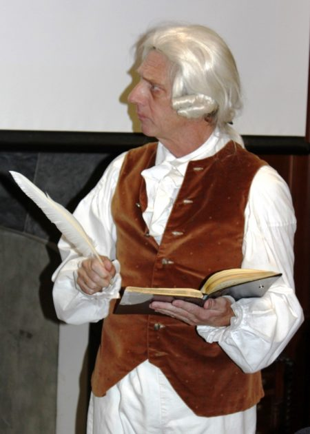 "Historic-site interpreter Steven Mumford performing in ""Who Done It: A Historic Murder Mystery."""