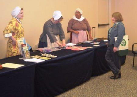 Staffing the Delaware display table at the American Revolution Museum in Yorktown. (From left) Sarah Zimmerman of the First State Heritage Park, and Vertie Lee and Gloria Henry of the John Dickinson Plantation. Connie Cooper of the Delaware Historical Society looks on.