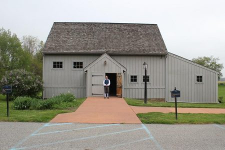 Historic-site interpreter Chris Merrill standing in front of the John Dickinson Plantation visitor center.