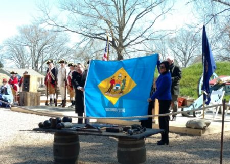 Unfurling the Delaware flag during the March 23, 2017 opening ceremony of the American Revolution Museum in Yorktown.
