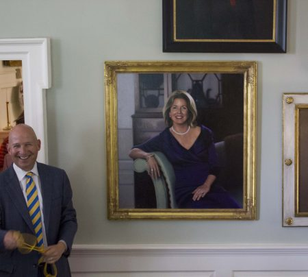 Former Gov. Jack Markell with the portrait of former Delaware first lady Carla Markell